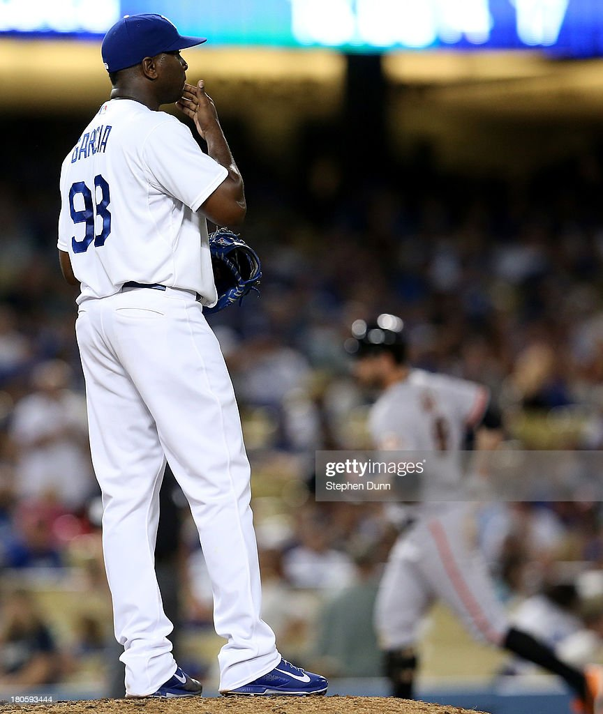 Relief pitcher Onelki Garcia #98 of the Los Angeles Dodgers reacts as <a gi-track='captionPersonalityLinkClicked' href=/galleries/search?phrase=Brandon+Belt&family=editorial&specificpeople=7513394 ng-click='$event.stopPropagation()'>Brandon Belt</a> #9 of the San Francisco Giants circles the bases after hitting a two run home run in the seventh inning at Dodger Stadium on September 14, 2013 in Los Angeles, California.