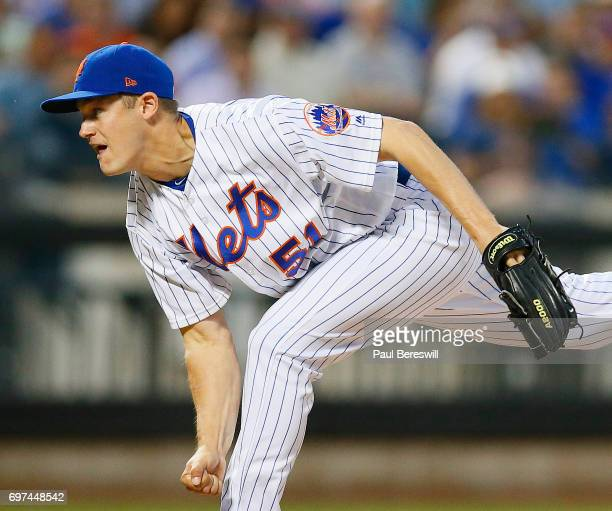 Relief pitcher Paul Sewald of the New York Mets pitches in an MLB baseball game against the Chicago Cubs on June 14 2017 at CitiField in the Queens...