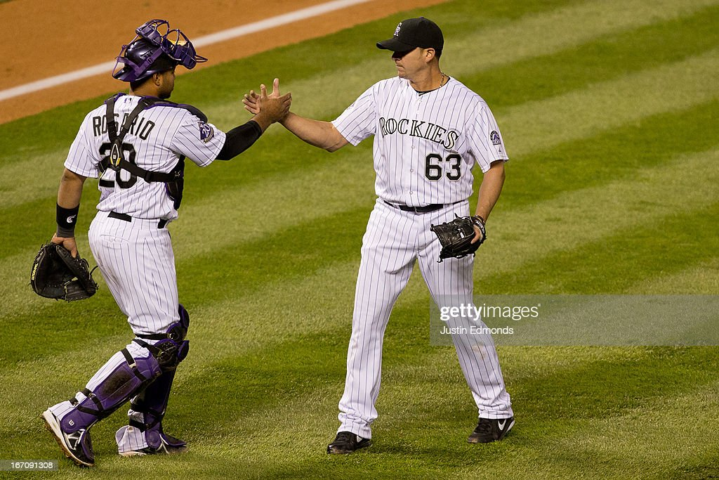 Relief pitcher <a gi-track='captionPersonalityLinkClicked' href=/galleries/search?phrase=Rafael+Betancourt&family=editorial&specificpeople=224728 ng-click='$event.stopPropagation()'>Rafael Betancourt</a> #63 and catcher <a gi-track='captionPersonalityLinkClicked' href=/galleries/search?phrase=Wilin+Rosario&family=editorial&specificpeople=5734314 ng-click='$event.stopPropagation()'>Wilin Rosario</a> #20 of the Colorado Rockies celebrate after recording the final out against the Arizona Diamondbacks at Coors Field on April 19, 2013 in Denver, Colorado. The Rockies defeated the Diamondbacks 3-1 to remain undefeated at home.