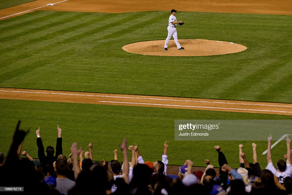 Relief pitcher <a gi-track='captionPersonalityLinkClicked' href=/galleries/search?phrase=Rafael+Betancourt&family=editorial&specificpeople=224728 ng-click='$event.stopPropagation()'>Rafael Betancourt</a> #63 of the Colorado Rockies celebrates along with the fans after recording the final out against the San Francisco Giants at Coors Field on May 17, 2013 in Denver, Colorado. The Rockies defeated the Giants 10-9.