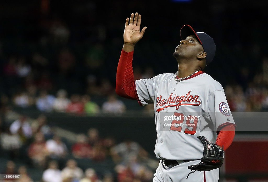 Relief pitcher <a gi-track='captionPersonalityLinkClicked' href=/galleries/search?phrase=Rafael+Soriano&family=editorial&specificpeople=587892 ng-click='$event.stopPropagation()'>Rafael Soriano</a> #29 of the Washington Nationals reacts after defeating the Arizona Diamondbacks in the MLB game at Chase Field on May 12, 2014 in Phoenix, Arizona. The Nationals defeated the Diamondbacks 6-5.