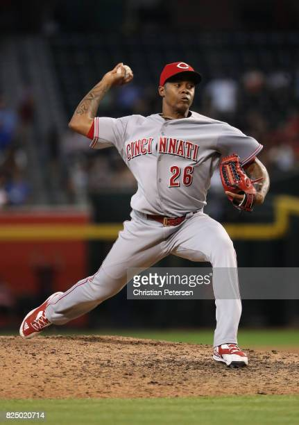 Relief pitcher Raisel Iglesias of the Cincinnati Reds pitches against the Arizona Diamondbacks during the MLB game at Chase Field on July 9 2017 in...