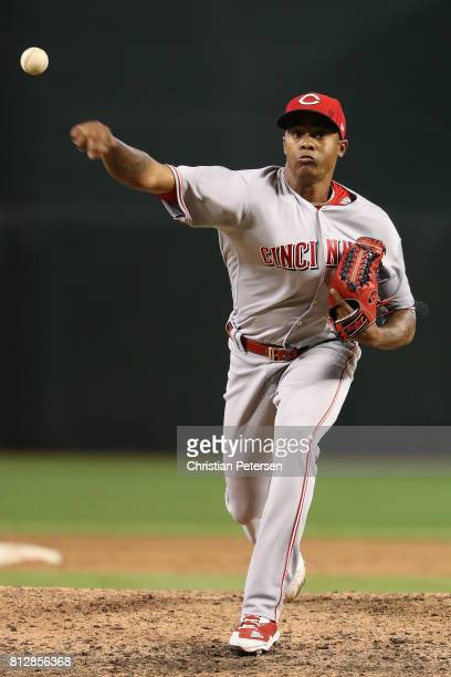 Relief pitcher Raisel Iglesias of the Cincinnati Reds throws a warm up pitch during the MLB game against the Arizona Diamondbacks at Chase Field on...