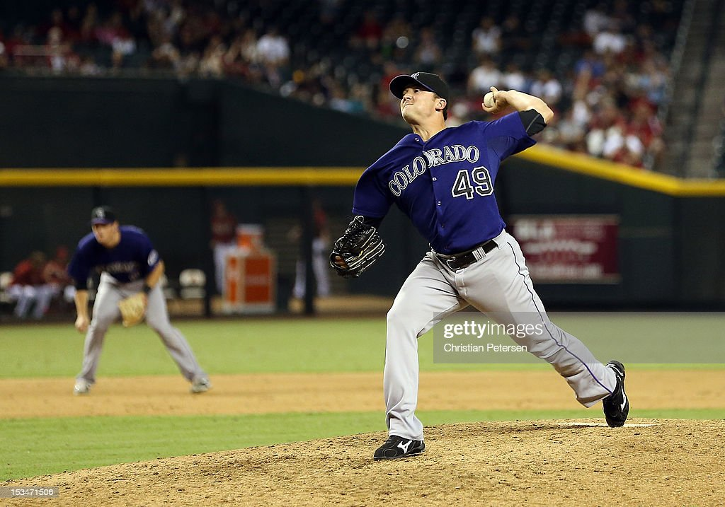 Relief pitcher Rex Brothers #49 of the Colorado Rockies pitches against the Arizona Diamondbacks during the MLB game at Chase Field on October 3, 2012 in Phoenix, Arizona.