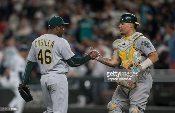 Relief pitcher Santiago Casilla of the Oakland Athletics and catcher Bruce Maxwell of the Oakland Athletics shake hands after a game against the...