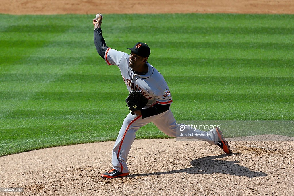 Relief pitcher <a gi-track='captionPersonalityLinkClicked' href=/galleries/search?phrase=Santiago+Casilla&family=editorial&specificpeople=682637 ng-click='$event.stopPropagation()'>Santiago Casilla</a> #46 of the San Francisco Giants delivers to home plate during the ninth inning against the Colorado Rockies at Coors Field on September 1, 2014 in Denver, Colorado. The teams were resuming a game previously suspended in the sixth inning on May 22 due to rain. The Giants defeated the Rockies 4-2.