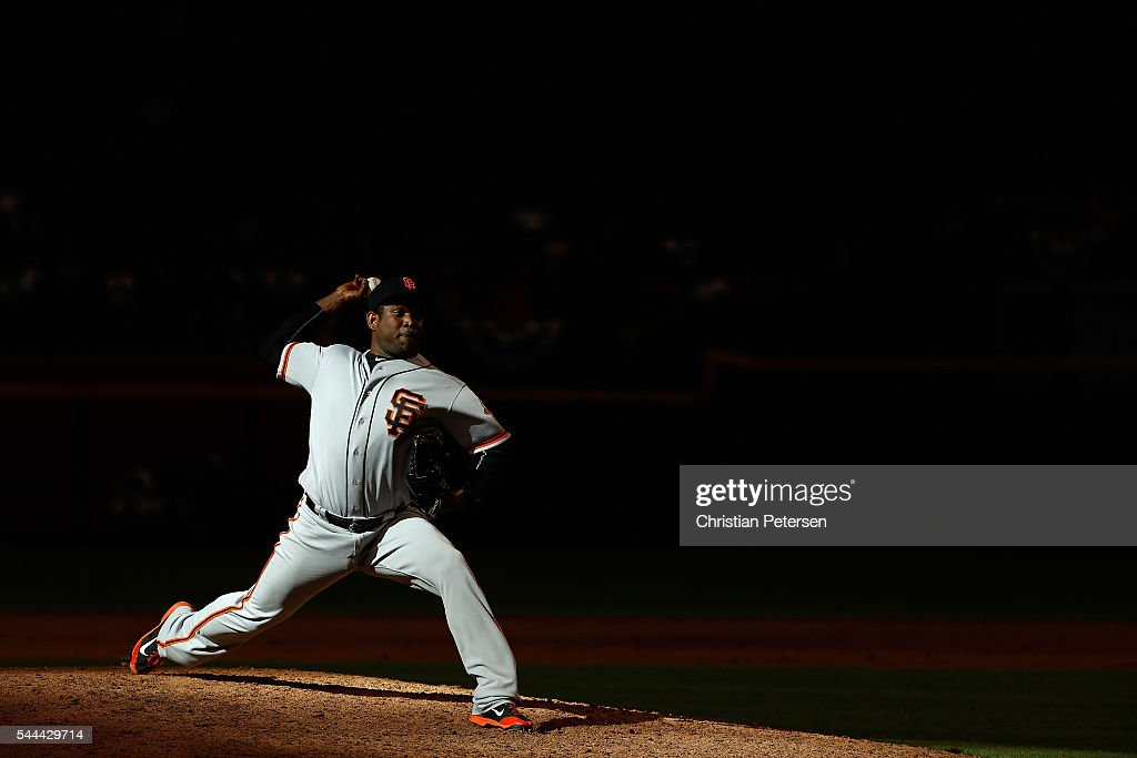 Relief pitcher Santiago Casilla of the San Francisco Giants pitches against the Arizona Diamondbacks during the 11th inning of the MLB game at Chase...