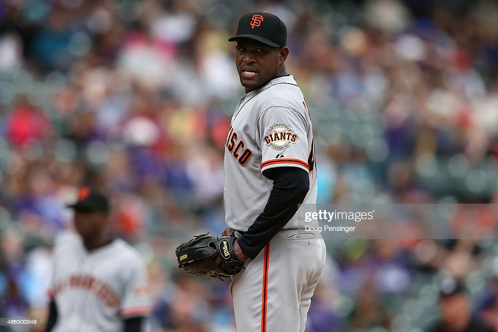 Relief pitcher <a gi-track='captionPersonalityLinkClicked' href=/galleries/search?phrase=Santiago+Casilla&family=editorial&specificpeople=682637 ng-click='$event.stopPropagation()'>Santiago Casilla</a> #46 of the San Francisco Giants reacts as he recorded a blown save against the Colorado Rockies at Coors Field on April 23, 2014 in Denver, Colorado. The Giants defeated the Rockies 12-10 in 11 innings.