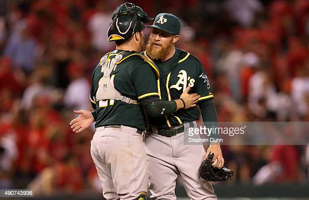 Relief pitcher Sean Doolittle of the Oakland Athletics celebrates with catcher Stephen Vogt after getting the final five outs and picking up the save...