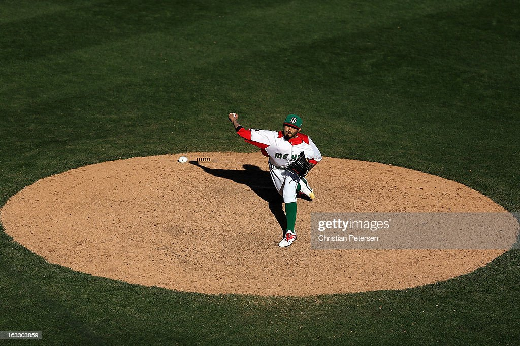 Relief pitcher <a gi-track='captionPersonalityLinkClicked' href=/galleries/search?phrase=Sergio+Romo&family=editorial&specificpeople=5433590 ng-click='$event.stopPropagation()'>Sergio Romo</a> #54 of Mexico pitches against Italy during the ninth inning of the World Baseball Classic First Round Group D game at Salt River Fields at Talking Stick on March 7, 2013 in Scottsdale, Arizona. Italy defeated Mexico 6-5.
