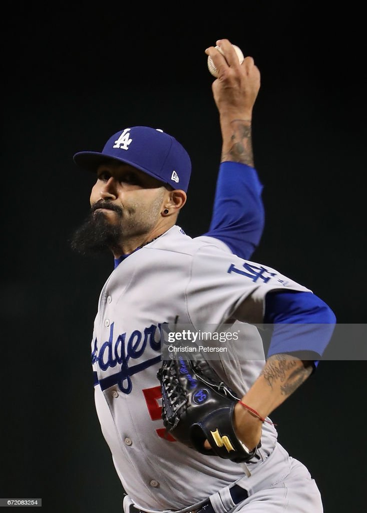 Relief pitcher Sergio Romo #54 of the Los Angeles Dodgers throws a warm up pitch during the MLB game against the Arizona Diamondbacks at Chase Field on April 21, 2017 in Phoenix, Arizona. The Diamondbacks defeated the Dodgers 13-5.