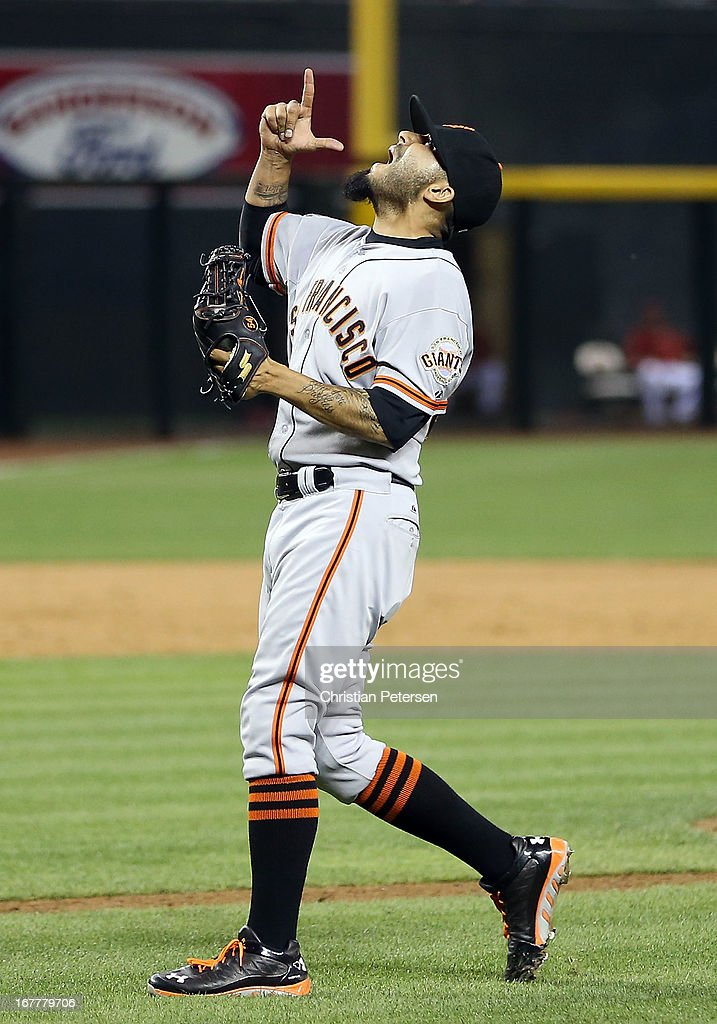 Relief pitcher <a gi-track='captionPersonalityLinkClicked' href=/galleries/search?phrase=Sergio+Romo&family=editorial&specificpeople=5433590 ng-click='$event.stopPropagation()'>Sergio Romo</a> #54 of the San Francisco Giants celebrates after defeating the Arizona Diamondbacks 6-4 in the MLB game at Chase Field on April 29, 2013 in Phoenix, Arizona.