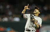 Relief pitcher Sergio Romo of the San Francisco Giants celebrates after defeating the Arizona Diamondbacks in the MLB game at Chase Field on June 22...