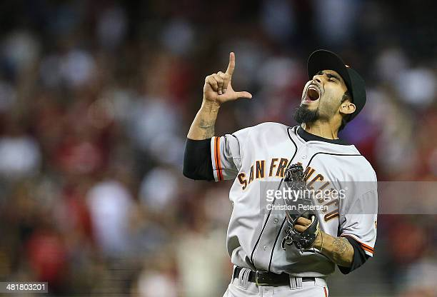 Relief pitcher Sergio Romo of the San Francisco Giants celebrates after defeating the Arizona Diamondbacks in the Opening Day MLB game at Chase Field...