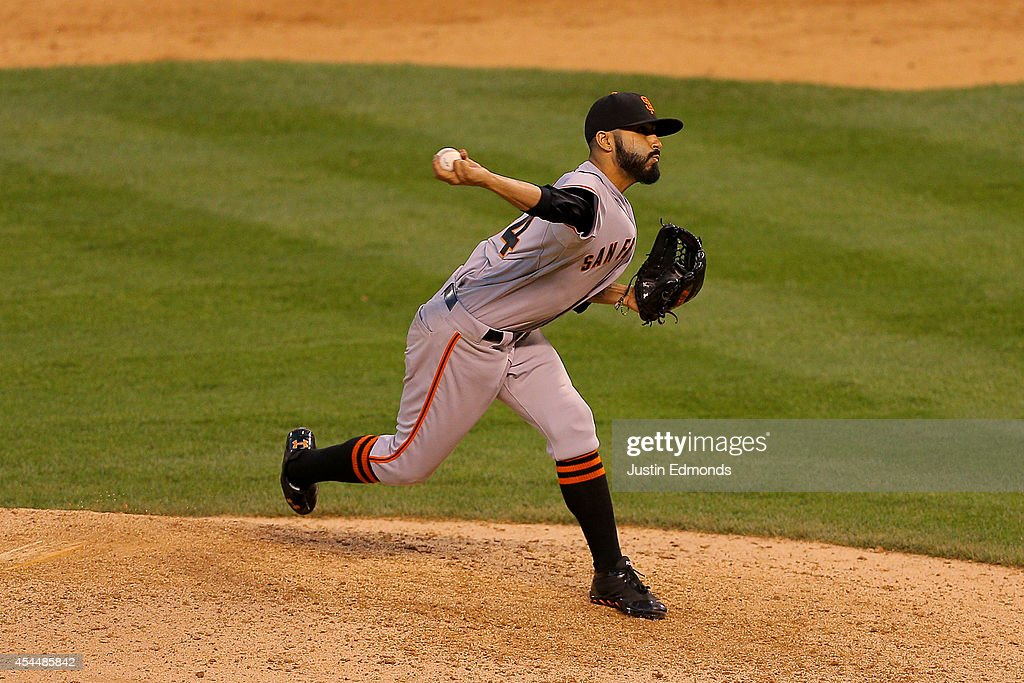 Relief pitcher <a gi-track='captionPersonalityLinkClicked' href=/galleries/search?phrase=Sergio+Romo&family=editorial&specificpeople=5433590 ng-click='$event.stopPropagation()'>Sergio Romo</a> #54 of the San Francisco Giants delivers to home plate during the ninth inning against the Colorado Rockies at Coors Field on September 1, 2014 in Denver, Colorado. The Rockies defeated the Giants 10-9 on a walk-off single by Charlie Blackmon.