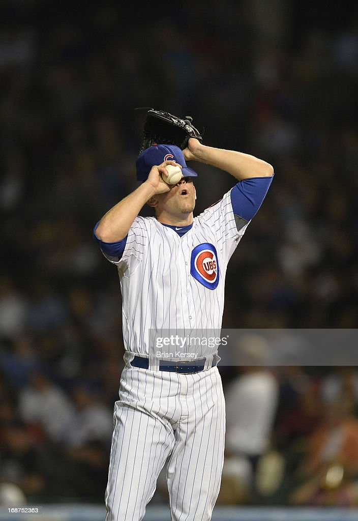 Relief pitcher <a gi-track='captionPersonalityLinkClicked' href=/galleries/search?phrase=Shawn+Camp&family=editorial&specificpeople=227958 ng-click='$event.stopPropagation()'>Shawn Camp</a> #54 of the Chicago Cubs adjusts his cap after giving up a solo home run to Carlos Gonzalez #5 of the Colorado Rockies in the ninth inning on May 14, 2013 at Wrigley Field in Chicago, Illinois.