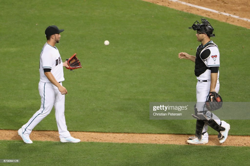 Relief pitcher Silvino Bracho #61 of the Arizona Diamondbacks celebrates with catcher Chris Iannetta #8 after defeating the San Diego Padres 9-3 in the MLB game at Chase Field on April 25, 2017 in Phoenix, Arizona.