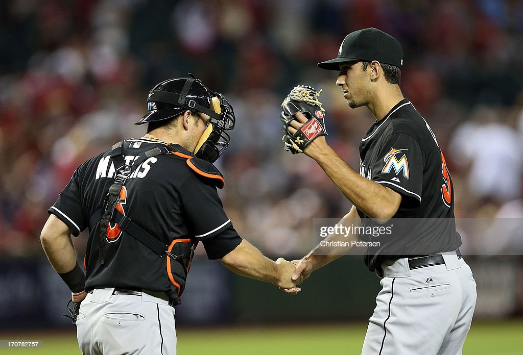 Relief pitcher <a gi-track='captionPersonalityLinkClicked' href=/galleries/search?phrase=Steve+Cishek&family=editorial&specificpeople=7542919 ng-click='$event.stopPropagation()'>Steve Cishek</a> #31 of the Miami Marlins celebrates with catcher <a gi-track='captionPersonalityLinkClicked' href=/galleries/search?phrase=Adeiny+Hechavarria&family=editorial&specificpeople=6926508 ng-click='$event.stopPropagation()'>Adeiny Hechavarria</a> #3 after defeating the Diamondbacks in the MLB game at Chase Field on June 17, 2013 in Phoenix, Arizona. The Marlins defeated the Diamondbacks 3-2.