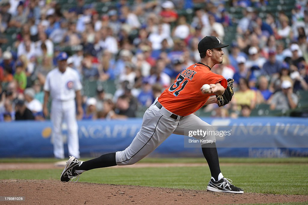 Relief pitcher <a gi-track='captionPersonalityLinkClicked' href=/galleries/search?phrase=Steve+Cishek&family=editorial&specificpeople=7542919 ng-click='$event.stopPropagation()'>Steve Cishek</a> #31 of the Miami Marlins delivers during the ninth inning against the Chicago Cubs at Wrigley Field on September 2, 2013 in Chicago, Illinois The Marlins defeated the Cubs 4-3.