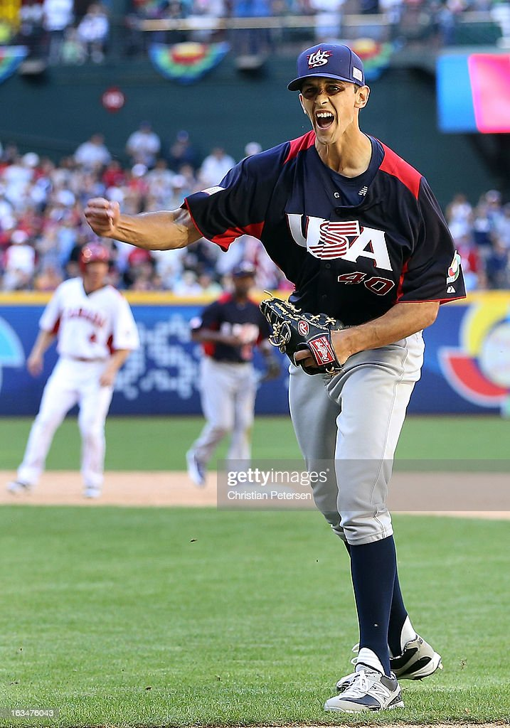 Relief pitcher Steve Cishek #40 of USA celebrates after getting out of the eighth inning against Canada during the World Baseball Classic First Round Group D game at Chase Field on March 10, 2013 in Phoenix, Arizona.