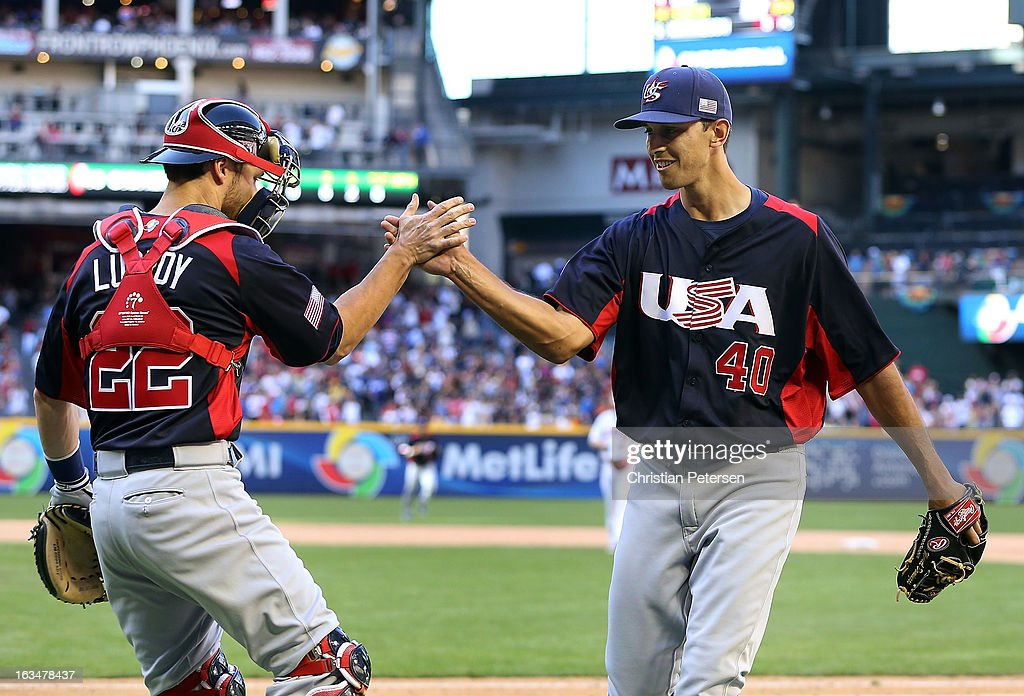 Relief pitcher Steve Cishek #40 of USA celebrates with catcher Jonathan Lucroy #22 after getting out of the eighth inning against Canada during the World Baseball Classic First Round Group D game at Chase Field on March 10, 2013 in Phoenix, Arizona. USA defeated Canada 9-4.