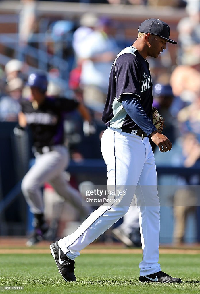 Relief pitcher Taijuan Walker #68 of the Seattle Mariners reacts after allowing a solo home run to Nolan Arenado #28 of the Colorado Rockies during the fourth inning of the spring training game at Peoria Stadium on March 4, 2013 in Peoria, Arizona.