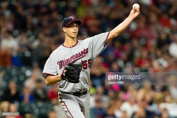 Relief pitcher Taylor Rogers of the Minnesota Twins throws out Lonnie Chisenhall of the Cleveland Indians at first to end the eighth inning at...