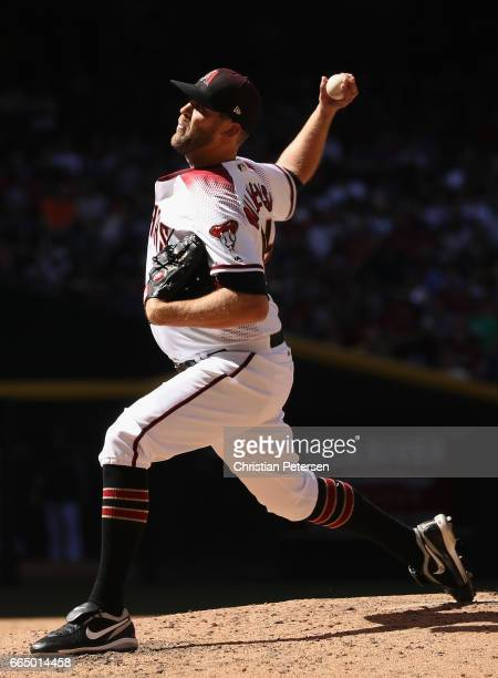 Relief pitcher Tom Wilhelmsen of the Arizona Diamondbacks pitches against the San Francisco Giants during the MLB opening day game at Chase Field on...