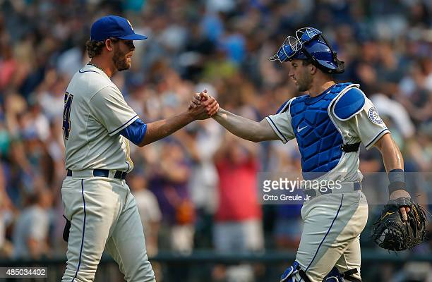 Relief pitcher Tom Wilhelmsen of the Seattle Mariners is congratulated by catcher Mike Zunino after defeating the Chicago White Sox 86 at Safeco...