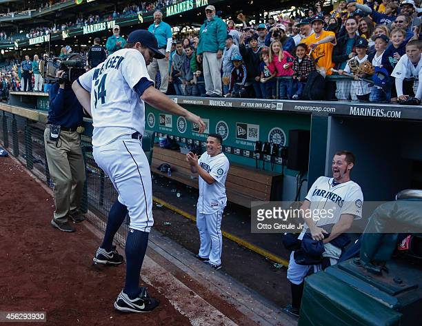 Relief pitcher Tom Wilhelmsen of the Seattle Mariners performs a dance after the game against the Los Angeles Angels of Anaheim at Safeco Field on...