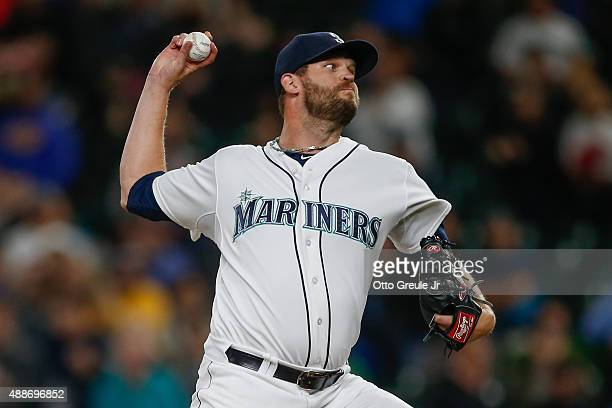 Relief pitcher Tom Wilhelmsen of the Seattle Mariners pitches against the Los Angeles Angels of Anaheim in the ninth inning at Safeco Field on...