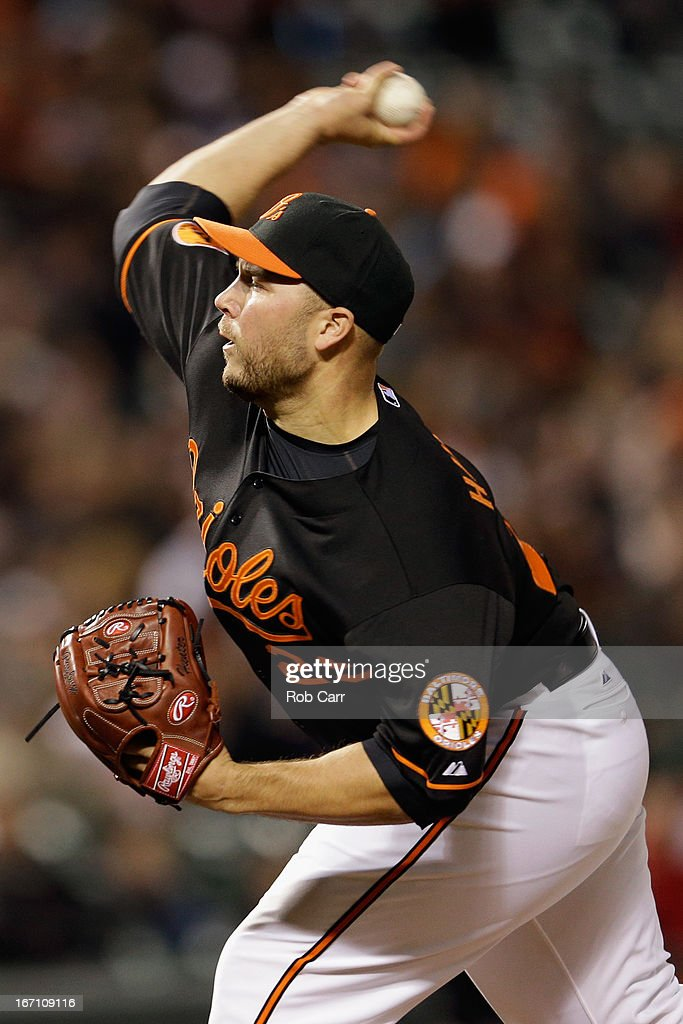 Relief pitcher Tommy Hunter #29 of the Baltimore Orioles throws to a Los Angeles Dodgers batter during the ninth inning of the Orioles 6-1 win during game two of a double header at Oriole Park at Camden Yards on April 20, 2013 in Baltimore, Maryland.