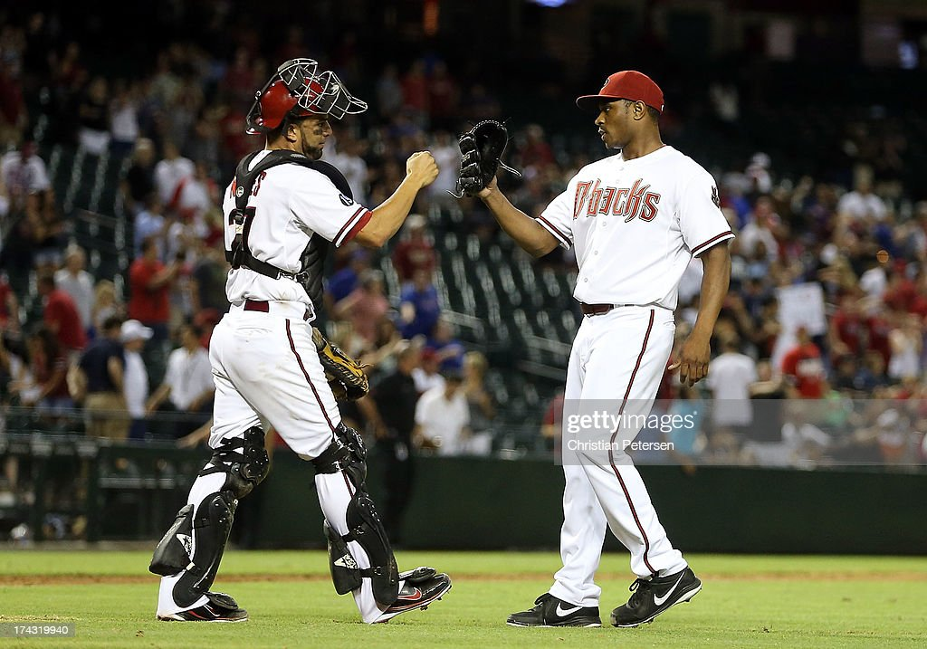 Relief pitcher Tony Sipp #49 of the Arizona Diamondbacks high fives catcher <a gi-track='captionPersonalityLinkClicked' href=/galleries/search?phrase=Wil+Nieves&family=editorial&specificpeople=835752 ng-click='$event.stopPropagation()'>Wil Nieves</a> #27 after defeating the Chicago Cubs in the MLB game at Chase Field on July 23, 2013 in Phoenix, Arizona. The Diamondbacks defeated the Cuibs 10-4.