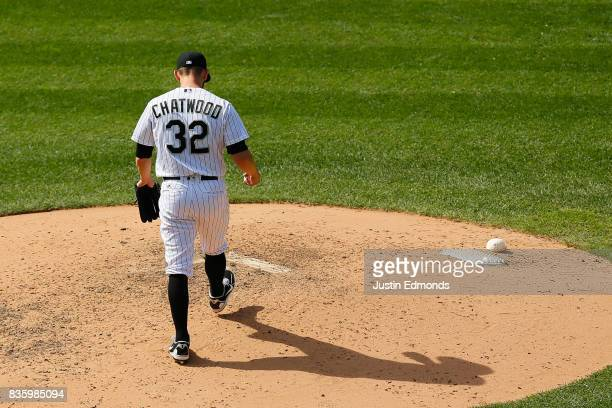 Relief pitcher Tyler Chatwood of the Colorado Rockies walks back to the mound after giving up a home run to Jesus Aguilar of the Milwaukee Brewers...