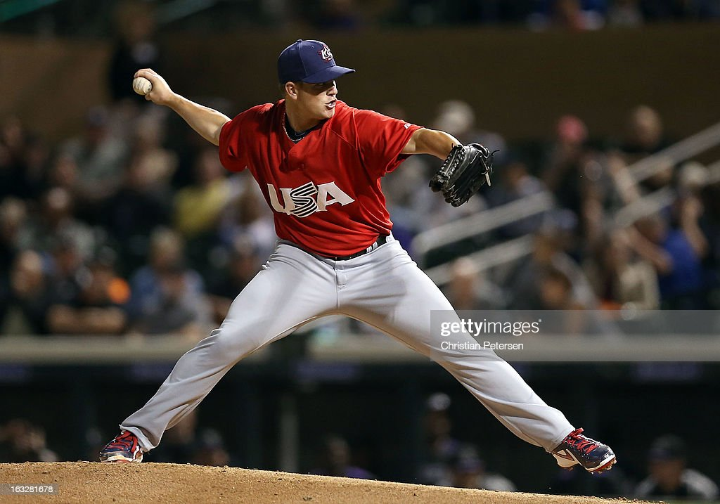Relief pitcher <a gi-track='captionPersonalityLinkClicked' href=/galleries/search?phrase=Vinnie+Pestano&family=editorial&specificpeople=4583581 ng-click='$event.stopPropagation()'>Vinnie Pestano</a> #52 of Team USA pitches against the Colorado Rockies during the spring training game at Salt River Fields at Talking Stick on March 6, 2013 in Scottsdale, Arizona.