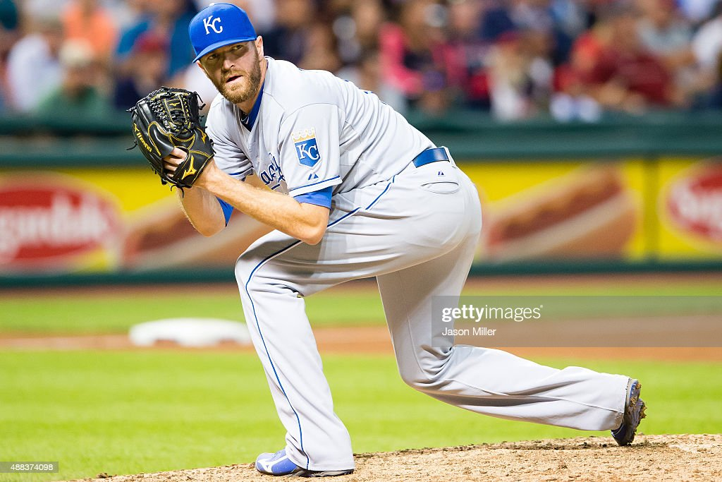 Relief pitcher <a gi-track='captionPersonalityLinkClicked' href=/galleries/search?phrase=Wade+Davis+-+Baseball+Player&family=editorial&specificpeople=8202494 ng-click='$event.stopPropagation()'>Wade Davis</a> #17 of the Kansas City Royals checks first during the eighth inning against the Cleveland Indians at Progressive Field on September 15, 2015 in Cleveland, Ohio.