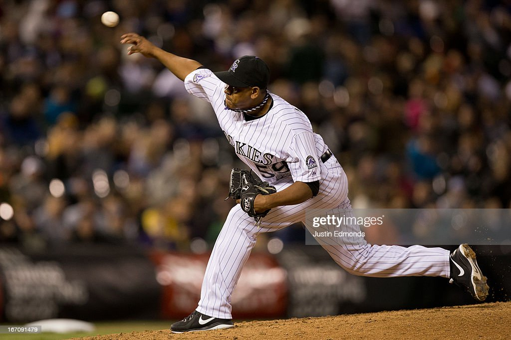 Relief pitcher <a gi-track='captionPersonalityLinkClicked' href=/galleries/search?phrase=Wilton+Lopez&family=editorial&specificpeople=4901786 ng-click='$event.stopPropagation()'>Wilton Lopez</a> #59 of the Colorado Rockies delivers to home plate during the seventh inning against the Arizona Diamondbacks at Coors Field on April 19, 2013 in Denver, Colorado. The Rockies defeated the Diamondbacks 3-1.