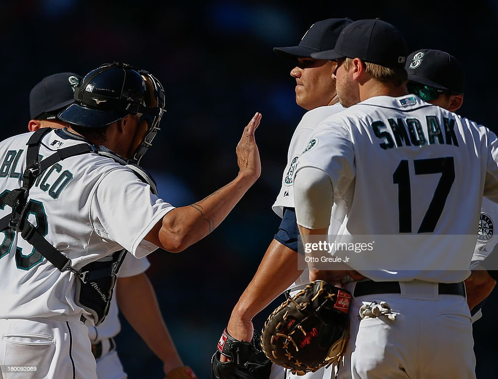Relief pitcher Yoervis Medina #31 of the Seattle Mariners is consoled by catcher <a gi-track='captionPersonalityLinkClicked' href=/galleries/search?phrase=Henry+Blanco&family=editorial&specificpeople=211366 ng-click='$event.stopPropagation()'>Henry Blanco</a> #33 after giving up a game-tying double to James Loney of the Tampa Bay Rays in the eighth inning at Safeco Field on September 8, 2013 in Seattle, Washington. The Rays defeated the Mariners 4-1.