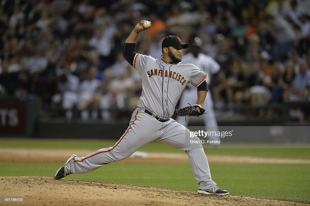 Relief pitcher Yusmeiro Petit #52 of the San Francisco Giants delivers a pitch during the sixth inning against the Chicago White Sox at U.S. Cellular Field on June 17, 2014 in Chicago, Illinois. The White Sox defeated the Giants 8-2.