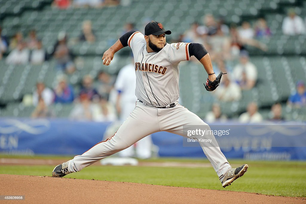 Relief pitcher <a gi-track='captionPersonalityLinkClicked' href=/galleries/search?phrase=Yusmeiro+Petit&family=editorial&specificpeople=4946649 ng-click='$event.stopPropagation()'>Yusmeiro Petit</a> #52 of the San Francisco Giants delivers a pitch during the fifth inning of a resumed game against the Chicago Cubs at Wrigley Field on August 21, 2014 in Chicago, Illinois. The game was initially called off in the early morning hours of August 20 over a protest from the Giants. Major League Baseball accepted the Giants' appeal, ruling the delay was caused by a mechanical failure of the tarp and changing the status of the game from cancelled and completed with a Cubs 2-0 win to a suspended game.