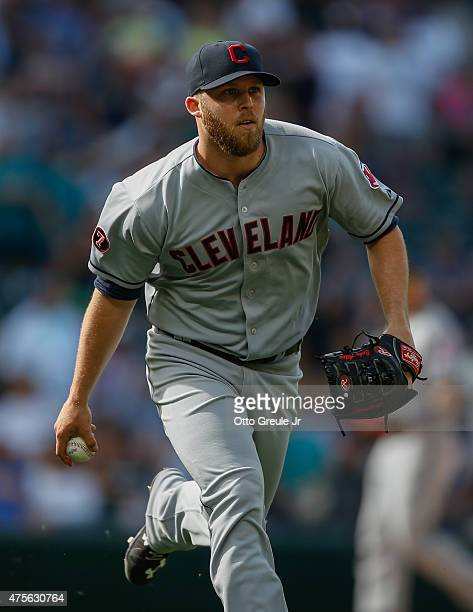 Relief pitcher Zach McAllister of the Cleveland Indians throws to first base on a groundout play against the Seattle Mariners at Safeco Field on May...