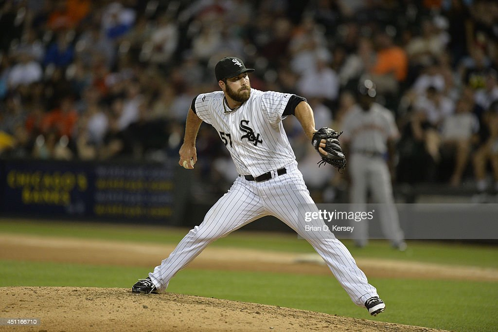 Relief pitcher Zach Putnam #57 of the Chicago White Sox delivers a pitch during the eighth inning against the San Francisco Giants at U.S. Cellular Field on June 17, 2014 in Chicago, Illinois. The White Sox defeated the Giants 8-2.