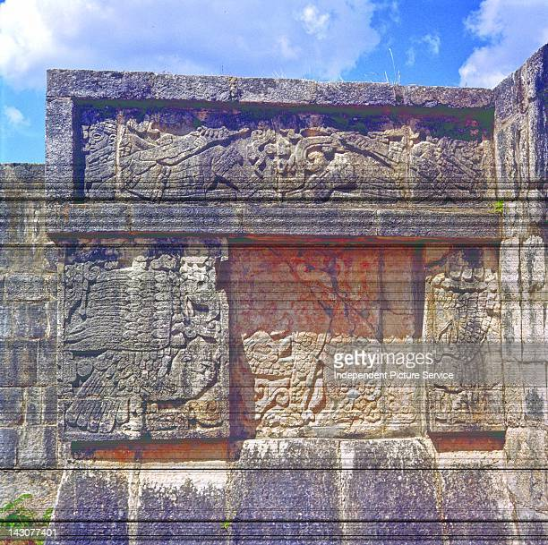 Relief sculpture depicting an eagle and a jaguar holding a human heart at the Temple of Jaguars and Eagles Chichen Itza Mexico