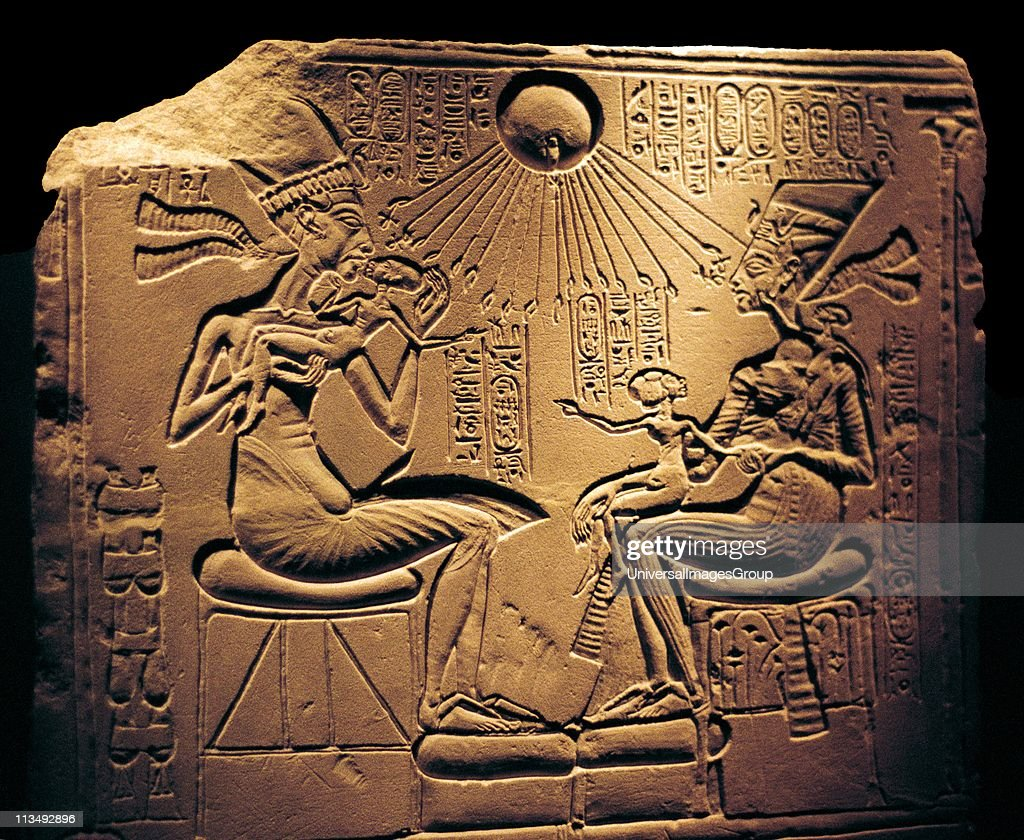 Relief showing Nefertiti (c1370-c1330 BC) Great Royal Wife (chief consort) and the Egyptian Pharaoh Akhenaten, and their children, with Aten, the sun's disc which they worshipped.