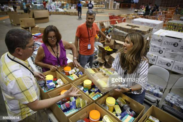 Relief supplies are sorted into boxes at the Roberto Clemente stadium to be sent out to those in need in the aftermath of Hurricane Maria on...