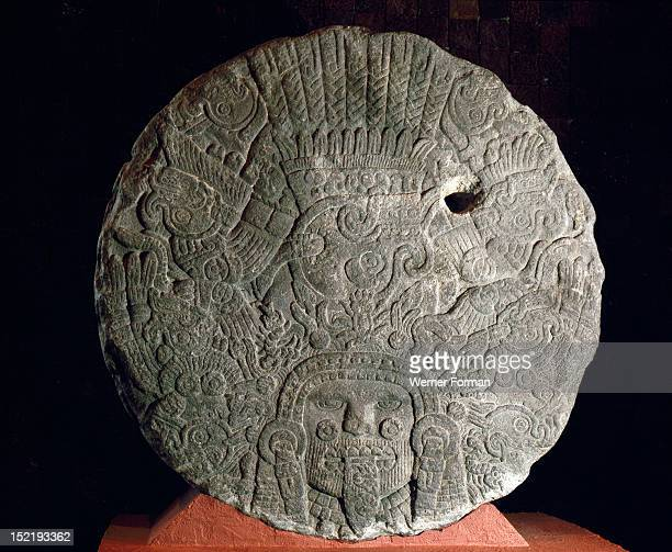 Relief with Tonatiuh the Sun god shown as a diving eagle surrounded by skulls He has a stone sacrificial knife as a tongue Mexico Aztec
