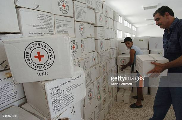 A relief workers of the International Committee of the Red Cross move kitchen sets and food August 22 200 in the village of AlQlaileh Lebanon Led by...