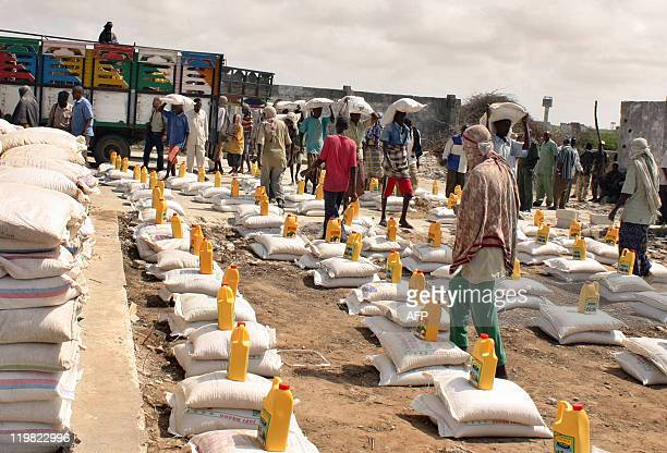 Relief workers prepare to distribute foodaid rations on July 25 2011 at an IDP camp in Mogadishu The UN on Monday urged 'massive' action to save...