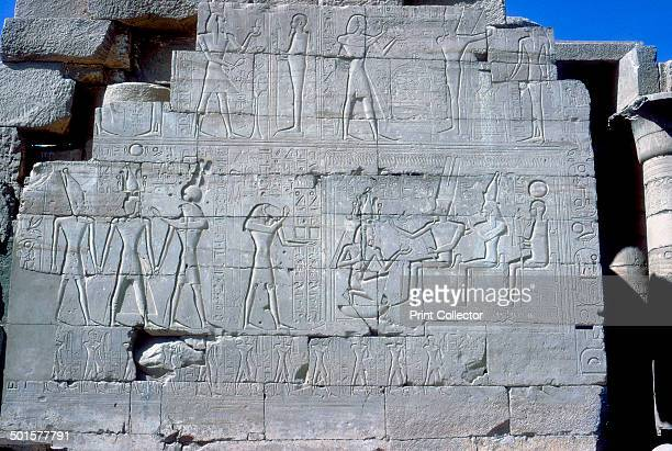 Reliefs of Rameses II with various gods The Ramesseum Temple of Rameses II Luxor Egypt Rameses II is depicted with Ptah and Min between Osiris and Ra...