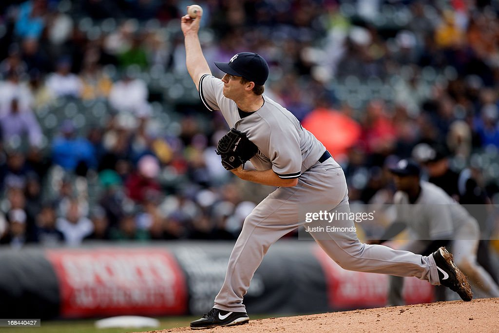 Reliever Adam Warren #43 of the New York Yankees pitches in the sixth inning against the Colorado Rockies at Coors Field on May 9, 2013 in Denver, Colorado. Warren earned the win as the Yankees defeated the Rockies 3-1 to win the series.